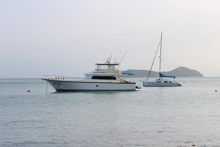 sailingboat: boat and  sailingboat on  Ao Yon Beach, Phuket Island, Thailand Editorial