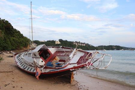 sailingboat: sailingboat after a storm on  Ao Yon Beach, Phuket Island, Thailand Stock Photo
