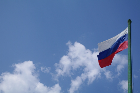Stock Photo - Russia national flag on the blue sky Stock Photo
