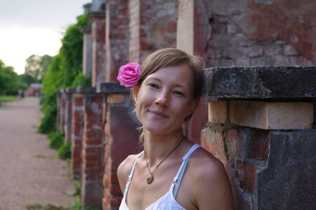 happy woman with a flower in her hair, Grand Peterhof Palace photo