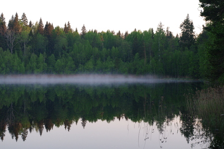 reflection water: dawn and water Reflection at the lake Pestovo,  Priozersky district, Leningrad region, Russia Archivio Fotografico