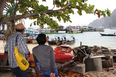 two man on the port in Thailand, Ko Phi Phi Don port, Boats photo
