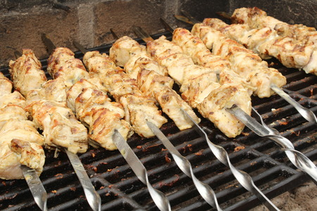 chargrill: A close up of the cooking shashlik on skewers Stock Photo