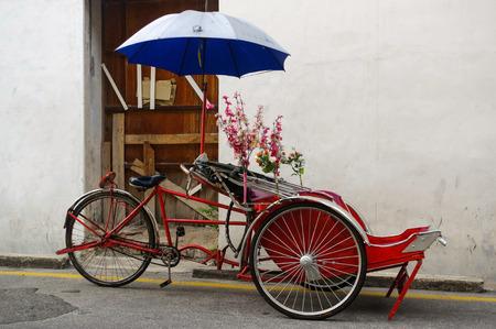 georgetown: Georgetown, Penang, Malaysia - April 18, 2015: Classic local rickshaw in George Town, Penang in Malaysia