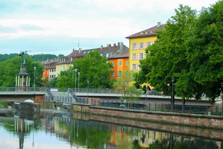 PFORZHEIM, GERMANY - JUNE 10, 2011: water reflection of colorful house in summer time