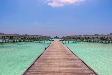 bungalows: Water bungalows on a tropical island - travel background Stock Photo