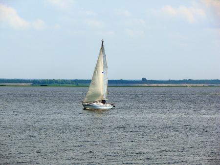 sailingboat: a Sailingboat on a lake at sunny day, Ukraine