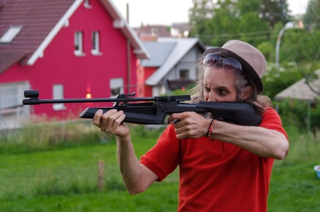 a young man shoot with air rifle Stock Photo