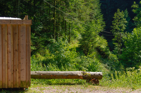 a Rustic old wooden public toilet in the forest Stock Photo