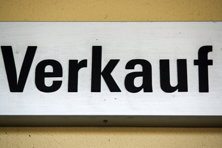 residenz: a sign or shield with - VERKAUF - in German, translation to English - SALE, closeup Stock Photo