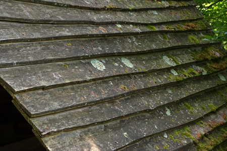 a wooden shingle on the roof of a house Stock Photo