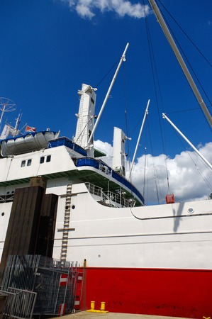 st pauli: HAMBURG, GERMANY - JULY 18, 2015: Close up of large shipping crane featuring stairs leading up to higher sections. MS Cap San Diego is a general cargo ship, situated as museum in - St Pauli