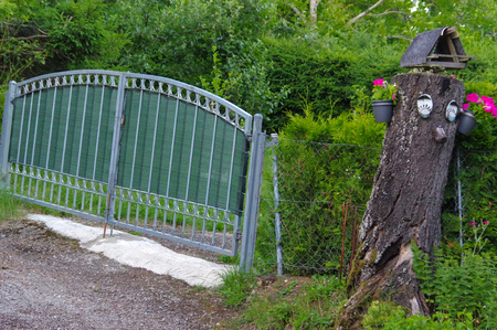 a Gate and Drive of a Country Estate Stock Photo
