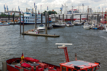 st pauli: HAMBURG, GERMANY - JUNE 18, 2015: The Landungsbruecken of St. Pauli are a very attractive spot for tourists and visitors who enjoy sightseeing in combination with maritime atmosphere