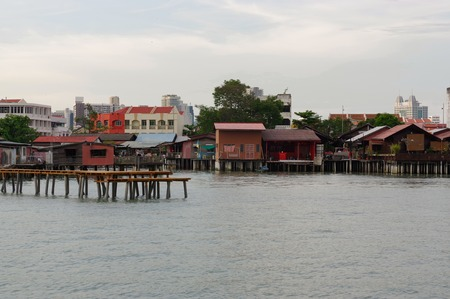 boatman: GEORGETOWN, PENANG, MALAYSIA - APRIL 18, 2016: the Lee Jetty is a small village built on water by the Chinese clan in the 19th century, as they could not get land.