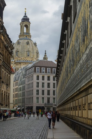 dresden: DRESDEN, GERMANY - JULY 13, 2015: the city center with historic buildings and the Fuerstenzug Procession of Princes , a giant mural Editorial
