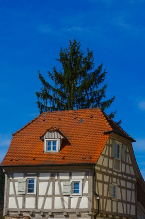 Residential tudor style house , with blue sky in background. Castle Neuenbuerg in Germany. Stock Photo