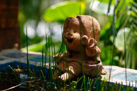 Little laughing buddha in a garden