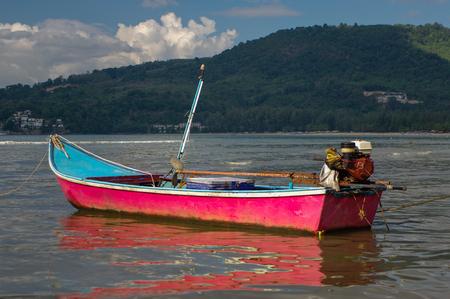 a pink boat on Kamala Beach in Thailand, Phuket island Stock Photo
