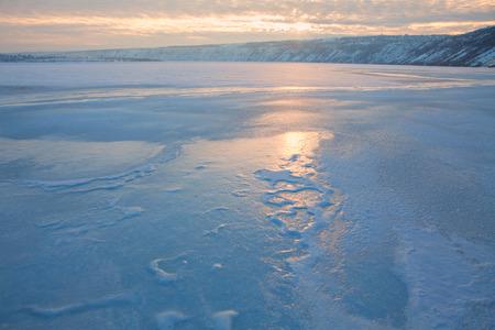 frozen lake: sunrise over frozen lake