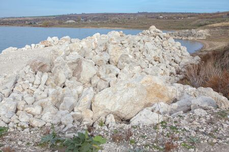 solids: pile of white stones