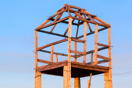 barbed wire frame: old guard tower