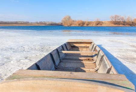 frozen river: boat on the frozen river