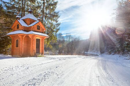 log cabin winter: blockhouse in the forest