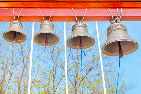 sonorous: bells against blue sky