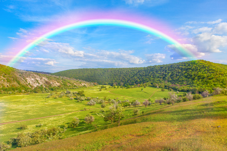 green hills: rainbow over the green hills Stock Photo