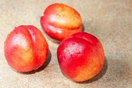 agro: three red nectarines