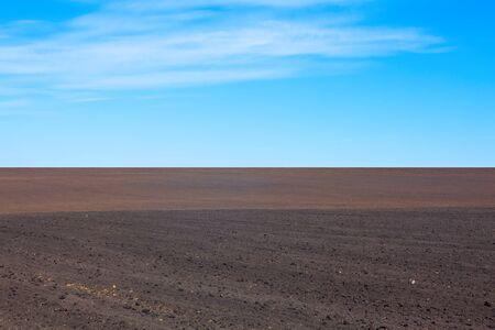 black soil: blue sky and black soil