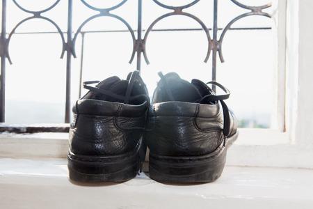 jaunty: shoes on the windowsill Stock Photo