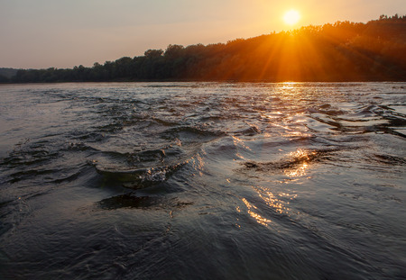 flowing river in the sunset