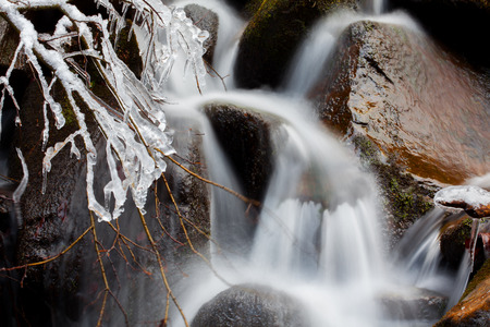 cascade: cascade with frozen water in the winter