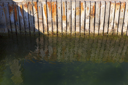 wooden fence in the water Stock Photo