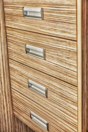 bedchamber: wooden modern nightstand Stock Photo