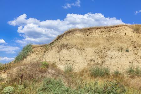 clay cliff  against blue sky