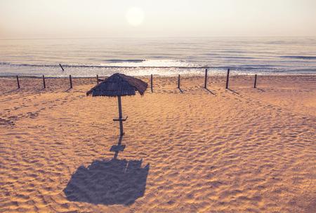 sunrise over the empty beach