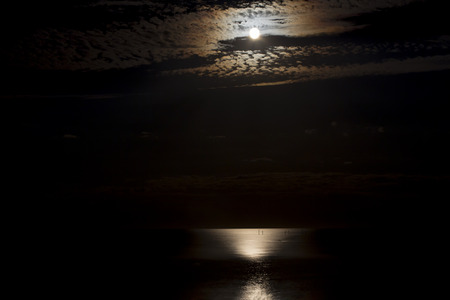 reflection of the moon in the sea Stock Photo
