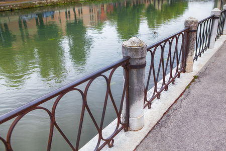 balustrade on the shore of the lake