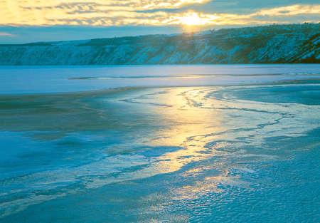 sunlight reflection in frozen lake