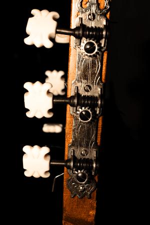 guitar mechanism with сhops on black background