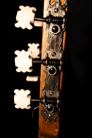 guitar mechanism with сhops on black background Stock Photo