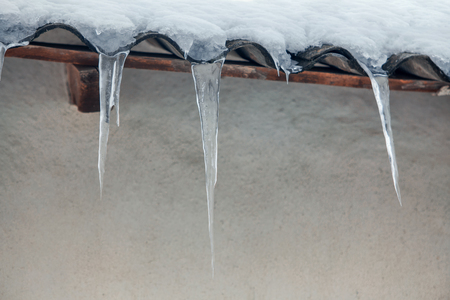 icicles hanging from the roof Stock Photo
