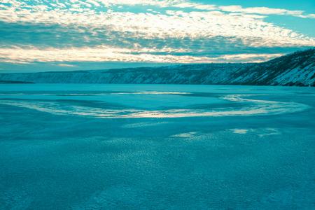 Blue ice of frozen lake landscape