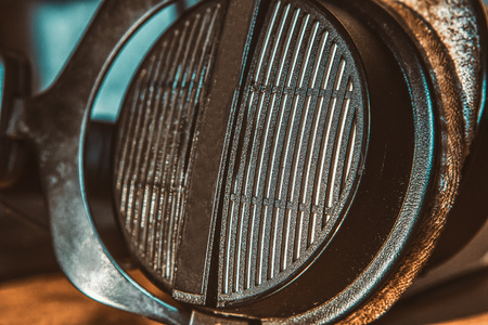 close up image of professional headphones colored in retro style