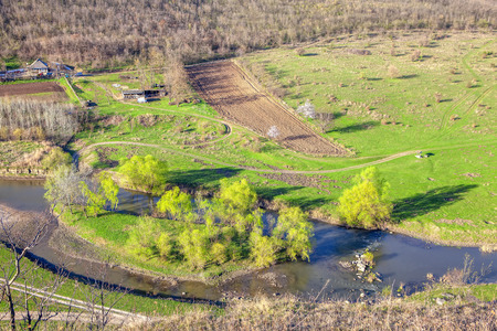 spring nature aerial view with little river