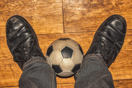 little ball and black shoes , amateur footballer