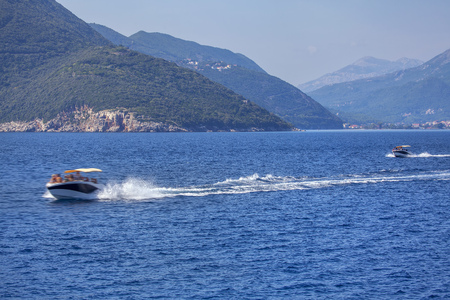 motorboats with tourists speeding on the bay
